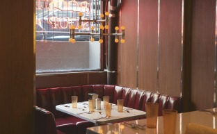 One of the booth tables at Rooster. There is also barstool seating. Photo Courtesy of Michael Persico